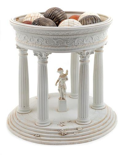 A Grand Tour Style Bisque Architectural Model with a Collection of Bone and Marble Ornaments Height of model 12 5/8 inches.