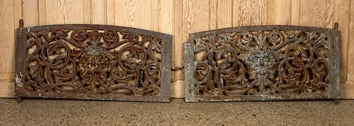 PAIR CAST IRON MASK AND SCROLL WINDOW GUARDS