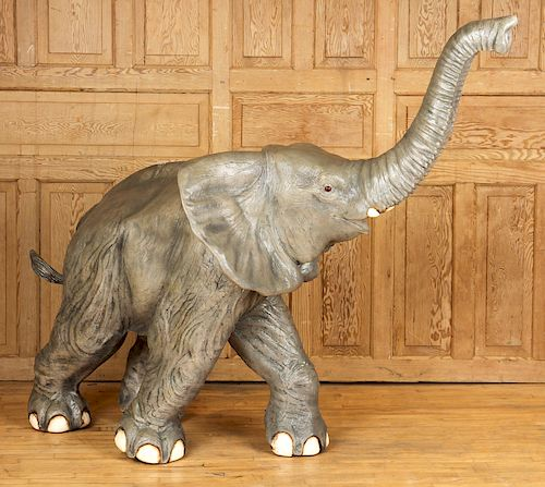 A FIBERGLASS FIGURE OF AN ELEPHANT