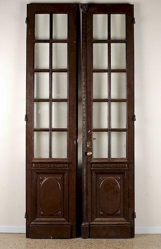 PAIR OAK DOORS WITH BEVELED GLASS PANELS