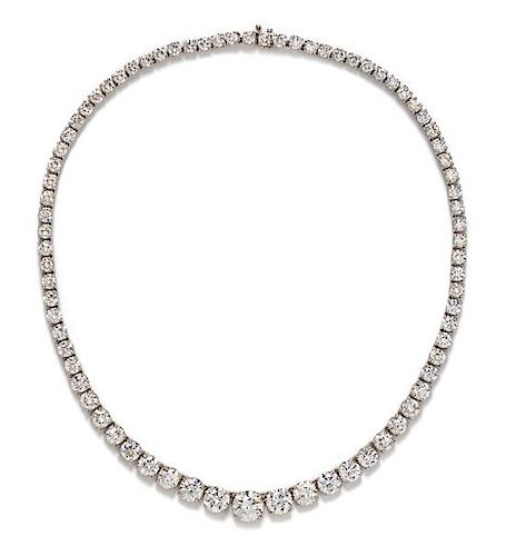A Platinum and Diamond Riviere Necklace, 37.90 dwts.