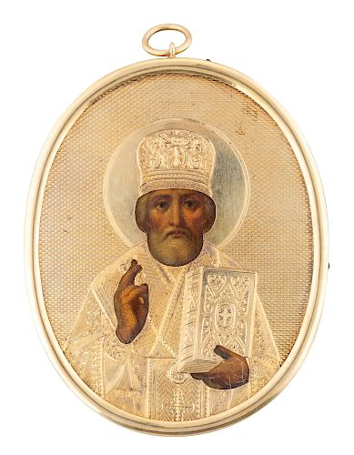 A RUSSIAN TRAVELING ICON OF ST. NICHOLAS THE WONDERWORKER WITH GILT SILVER OKLAD, WORKMASTER A. TOBINKOV, ST. PETERSBURG, 1870-1872