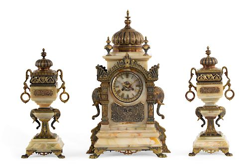 A French Indo-Persian style clock garniture