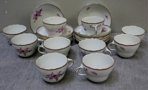 Meissen Porcelain Group of Cups and Saucers.