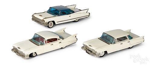Three Japanese tin friction Cadillacs