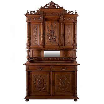 Buffet. Francia. Siglo XX. Estilo Enrique II. En talla de madera de roble. Con 5 puertas abatibles, 2 cajones con tiradores de metal.