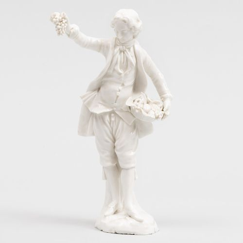 Vienna Porcelain White Figure of a Boy with Fruit Basket