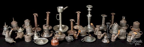 Large collection of pewter and tin lighting