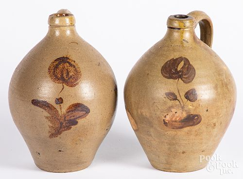 Two similar stoneware jugs
