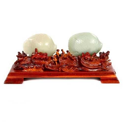Two carved jade fish.