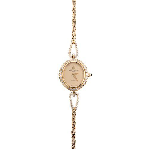 A Baume & Mercier Watch with Diamonds in 18K