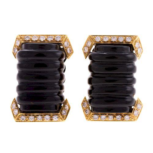 A Pair of Carved Onyx & Diamond Earrings in 18K