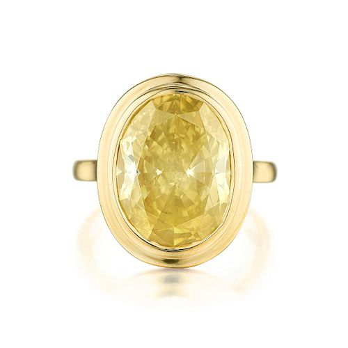 A 7.32-Carat Oval-Cut Fancy Yellow Diamond Ring