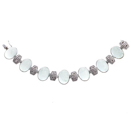 A Cabochon Aquamarine & Diamond Bracelet in 14K
