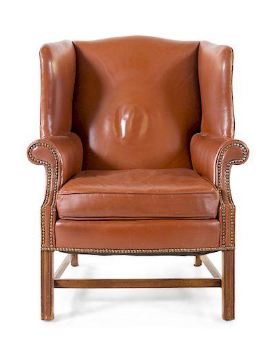 A Georgian Style Wingback Armchair<br>19TH/20TH C