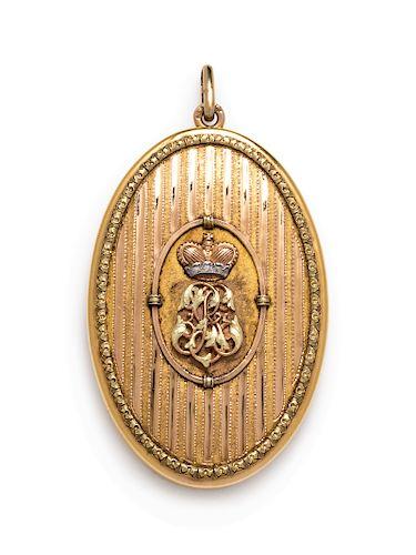 An Art Nouveau 14 Karat Bicolor Gold Mirrored Locket/Pendant, Henrik Wigstrom,