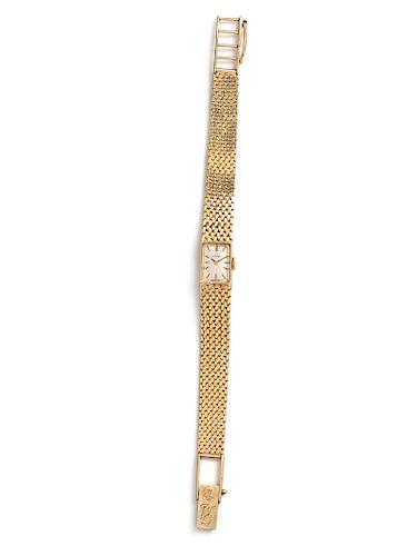 A 14 Karat Yellow Gold Wristwatch, Omega,