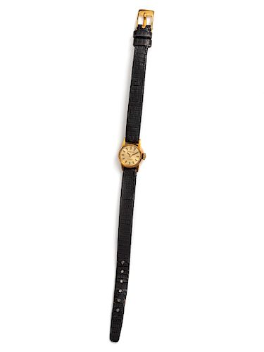 An 18 Karat Yellow Gold Wristwatch. Tiffany and Co.,
