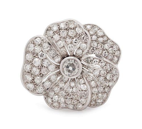 A Platinum and Diamond Flower Motif Brooch,