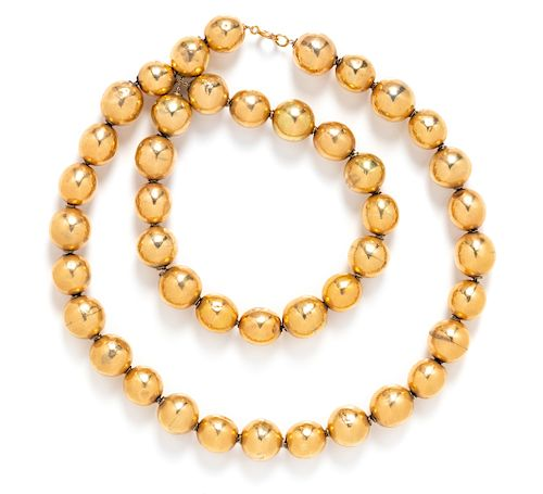 A 14 Karat Yellow Gold Bead Necklace,