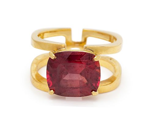 An 18 Karat Yellow Gold and Reddish Orange Sapphire Ring,