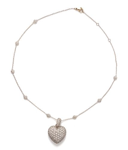A White Gold and Diamond Heart Pendant/Necklace,