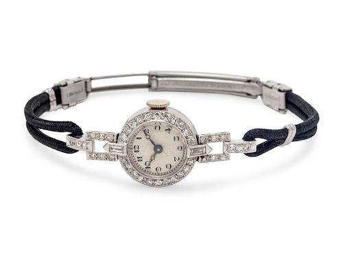 A Platinum and Diamond Wristwatch,