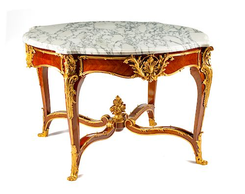 A Louis XV Style Gilt Bronze Mounted Center Table