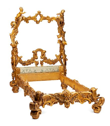 A Venetian Carved and Parcel Gilt Bed Frame