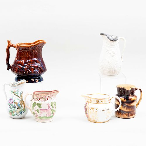 Group of Six Porcelain and Pottery Pitchers
