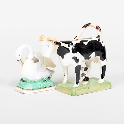 Staffordshire Cow Creamer and a Chamberlains Worcester Porcelain Swan