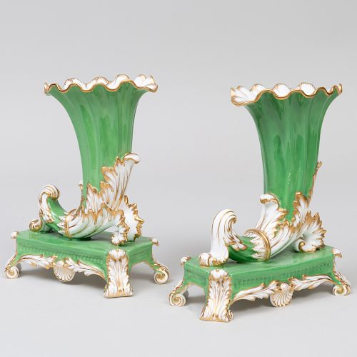 Pair of English Porcelain Apple Green Ground Cornucopia Vases on Stands