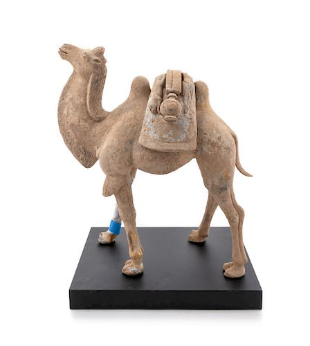 A Pottery Figure of a Bactrian Camel Height 17 1/2 in., 44 cm.