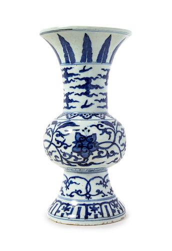 A Blue and White Porcelain Gu Vase Height 13 3/8 in., 34 cm.