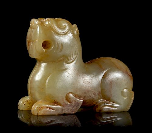 A Celadon and Russet Jade Mythical Beast Height 1 1/2 in., 4 cm.