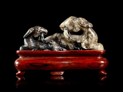 A Grey and Black Jade Figural Group of Double Rams Length 3 1/4 x height 1 1/2 in., 8 x 4 cm.
