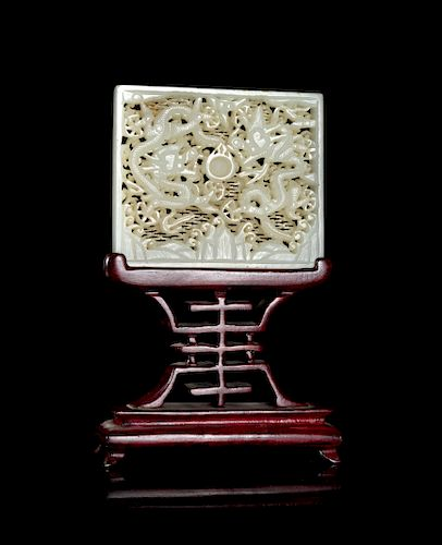 A White Jade Reticulated 'Dragon' Belt Plaque Height 2 1/2 x 3 in., 6 x 8 cm.