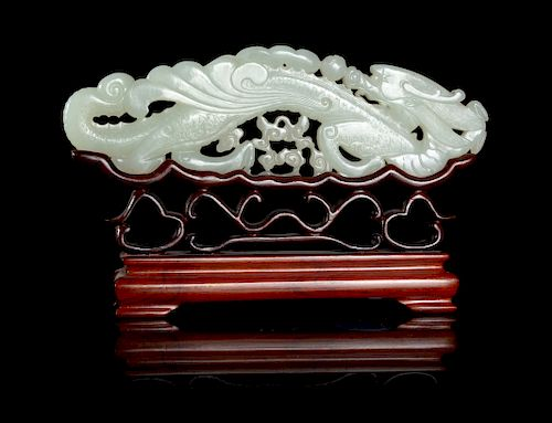 A Large White Jade 'Dragon' Plaque Width 7 in., 18 cm.