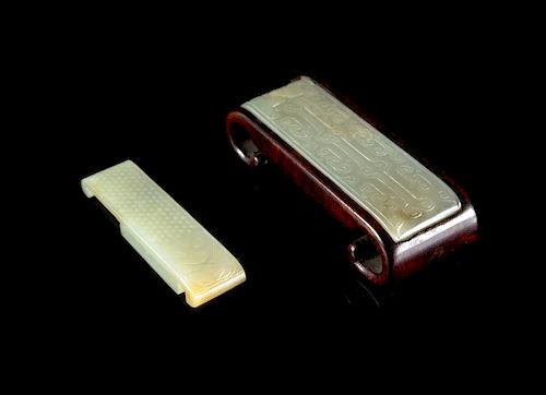Two White Jade Sword Slides Larger: 3 1/4 in., 8 cm.