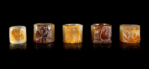Five Carved Agate Archer's Rings Largest Interior: diam 0 7/8 in., 2 cm. Largest Overall: diam 1 1/2 in., 4 cm.