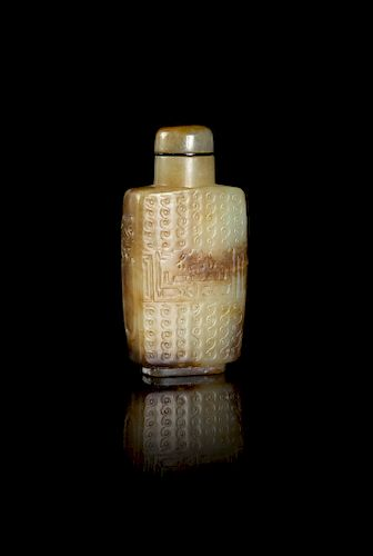 A Russet and Celadon Jade 'Kuilong' Snuff Bottle Height 2 1/2 in., 6 cm.