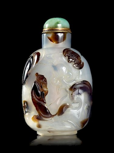 A Silhoutte Carved Agate Snuff Bottle Height 2 3/8 in., 6 cm.