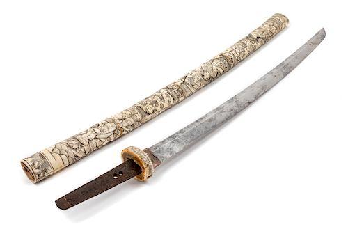 A Japanese Katana Blade length 20 1/2 in., 52 cm. Overall length 32 3/8 in., 82 cm.