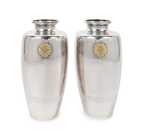 A Pair of Japaneses Sterling Vases Each: height 12 in., 30 cm.