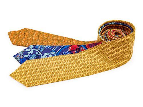 Three Hermes silk ties, one blue, one yellow, one brown
