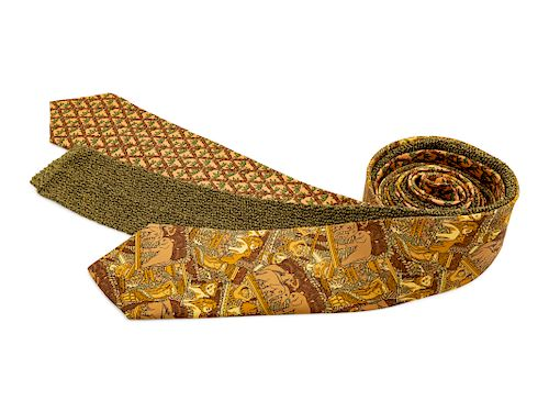 Three Hermes ties, one peach with bamboo print, one yellow and brown animal print, one olive green knit