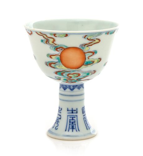 A Chinese Doucai 'Sun' Porcelain Stem Cup Height 3 1/2 in., 8.9 cm.