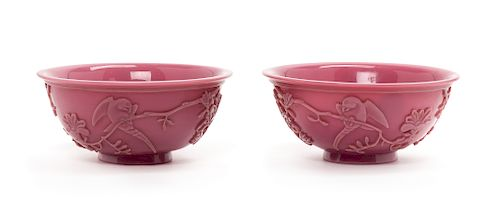 A Pair of Chinese Mauve Peking Glass Bowls Each: diam 6 3/4 in., 17 cm.