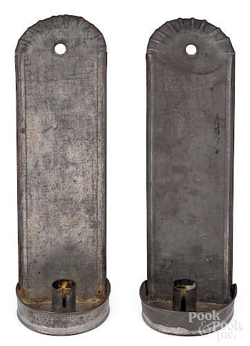 Pair of tin candle sconces, 19th c.