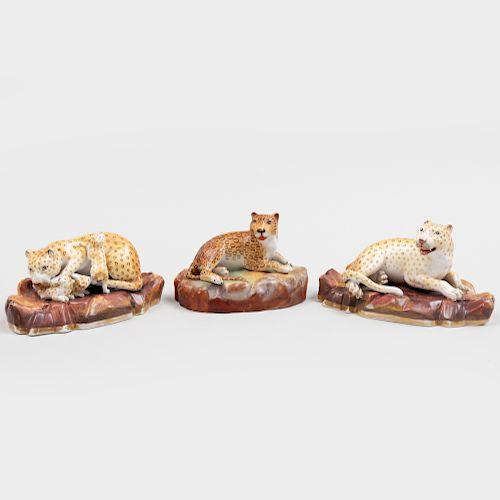 Jacob Petit Porcelain Model of a Recumbent Leopard and a Pair of Continental Porcelain Leopards
